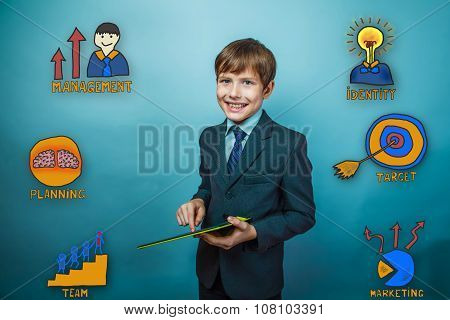 Teenage boy holding a tablet and laughing happily contented coll