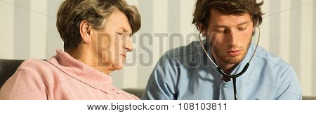 Physician Examining Woman
