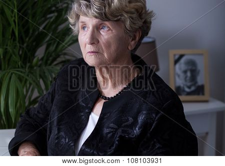 Thoughtful Elderly Widow