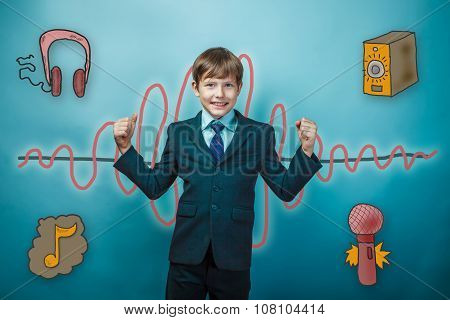 Teenage boy in a business suit laughs and shows the strength of