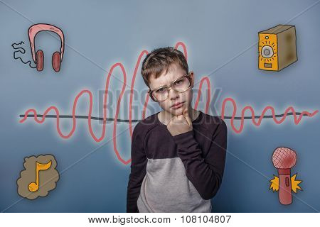 Teenage boy in glasses propped his chin with his fist thought se