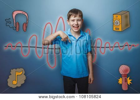teenage boy laughing and showing his finger down the sound wave