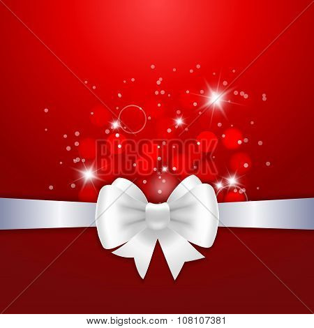 White Ribbon And Bow On Red Background.