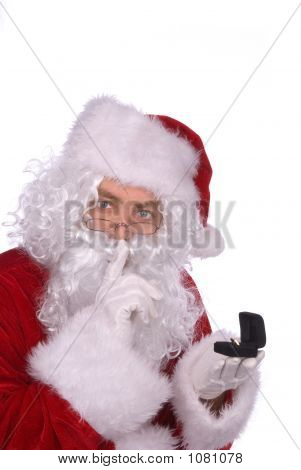Santa Claus Is Placing A Ring