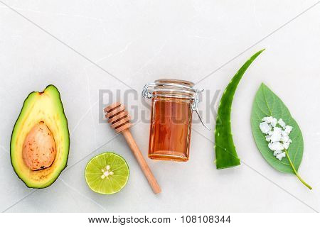 Alternative Skin Care  And Scrub Fresh  Avocado , Leaves ,sea Salt , Oils, Lime And Honey On Marble