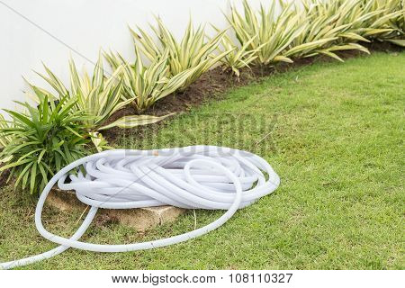 Roll Of Plastic Water Hose In The Garden