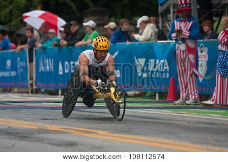 Wheelchair Athlete Speeds Toward Finish Line Of Peachtree Road Race
