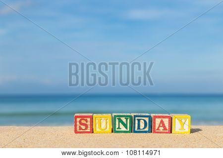 Word Sunday In Colorful Alphabet Blocks On Tropical Beach