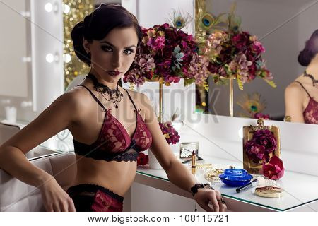 elegant beautiful sexy girl in lace lingerie in a retro style with beautiful hair and makeup in the