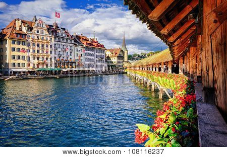 Lucerne, Switzerland, View From The Famous Wooden Chapel Bridge To The Old Town
