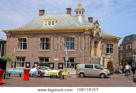 People Resting On Benches Near City Hall Of Zandvoort,  The Netherlands
