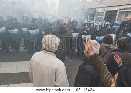People Confronting Riot Police In Milan, Italy