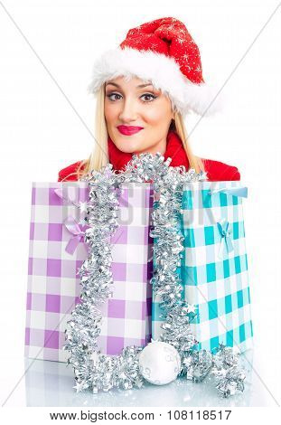 Cute Christmas Or Santa Claus Woman With Shopping Bags - Gift. Isolated On White, Close Up