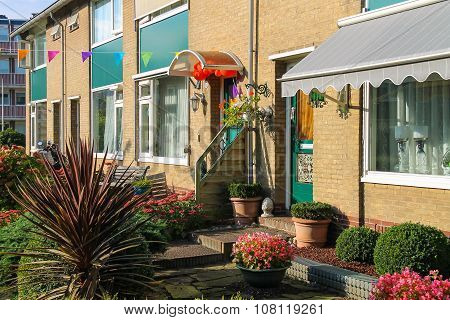 Picturesque Residential House With Decorative Plants Before It In Small Dutch Town Zwanenburg, The N