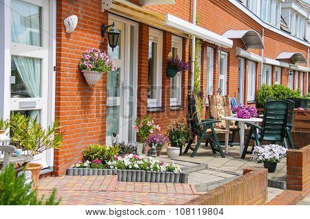 Street View Of Traditional House Decorated With Plants And Furniture In Zandvoort, The Netherlands