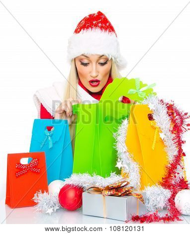 Surprised Christmas Woman With Shopping Bags - Gift. Isolated On White, Close Up