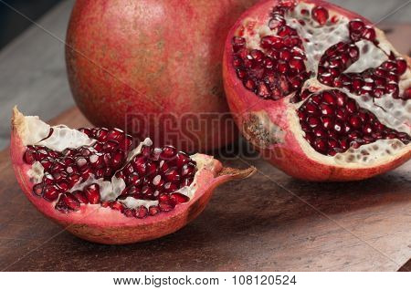Pomegranate On A Timber Board