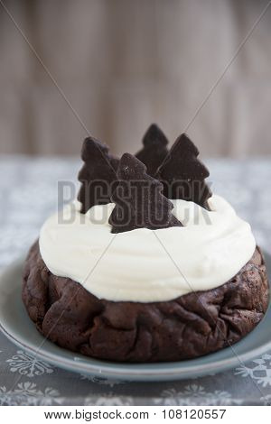 Chocolate cake with clotted cream and christmas trees