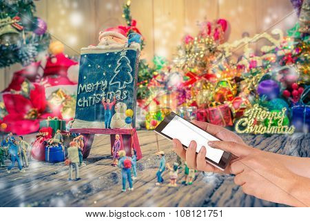 Image Of Male Hand Using Phone On The Plane And Christmas Ornaments