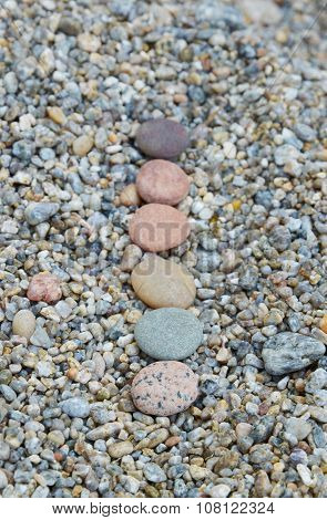 Row Of Colored Smooth Stones Polished By Baikal Lake. Focus On First