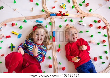 Kids Playing With Wooden Train Set