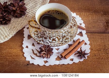 Photo of glowing white and golden cup with tasty coffee, Christmastime table setting, tea mug on bro