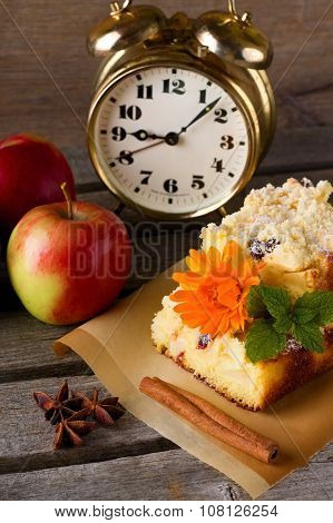 Apple Cake With Brass Alarm Clock And Spice