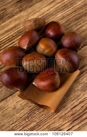 Several Sweet Chestnuts On Wooden Board