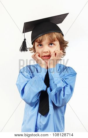 Little tired professor in academic hat on white background