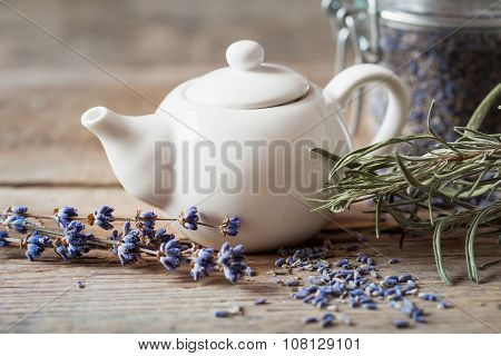 Teapot Of Healthy Herbal Tea, Dry Lavender Flowers And Jar With Dry Lavender.