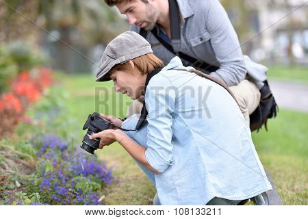 Photographers in park shooting vegetation