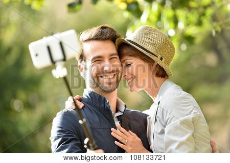 In love couple taking selfie picture with smartphone
