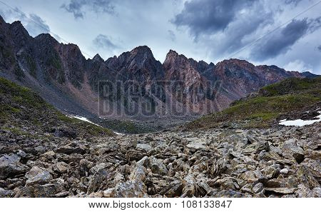 Sharp Fragments Of Rock On Background Of A Mountain Range. Eastern Sayan. The Republic Of Buryatia