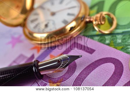 Pocket Watch, Euro Bills And Ink Pen