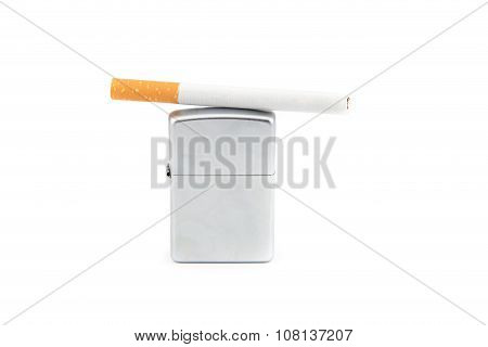 Lighter and cigarette on white background