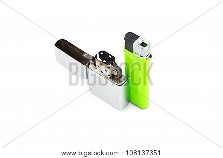 Iorn and plastic lighters on white background