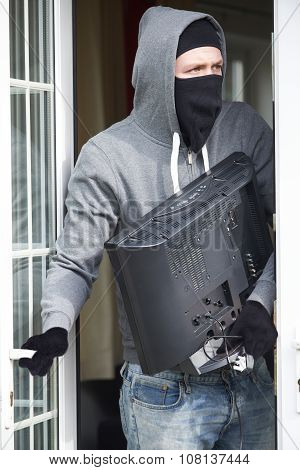Burglar Breaking Into House And Stealing Television