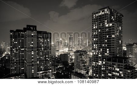 Condominiums and towers in Bangkok at night