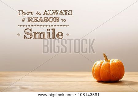 There Is Always A Reason To Smile Message With Orange Pumpkin