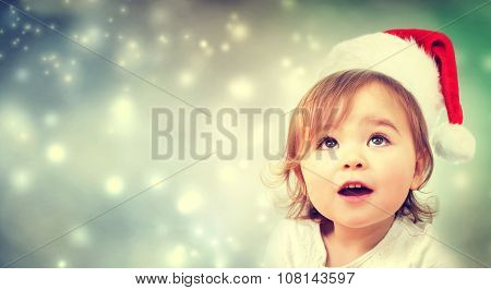 Happy Toddler Girl With Santa Hat