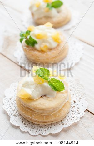 Pineapple Tart With Fresh Cream In Puff Pastry On White Wooden Board