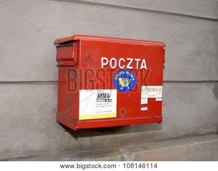 KRAKOW, POLAND - JUNE 08, 2007: Polish National Post red mailbox on the street of Krakow. Polish postal service was established in 1558 by starting permanent postal route between Krakow and Venice