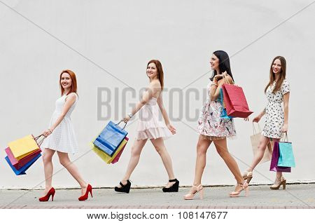 four Women with Shopping Bags on walk