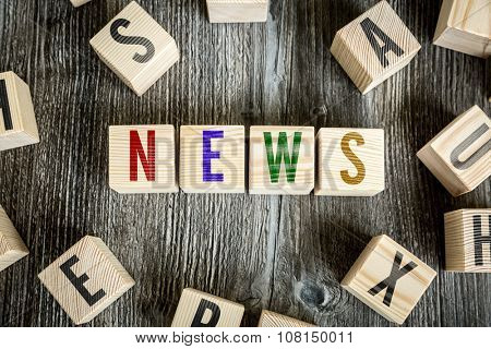 Wooden Blocks with the text: News