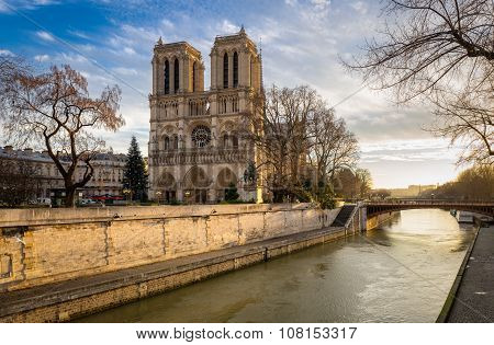 Notre Dame Cathedral And Seine River On Winter Morning Paris