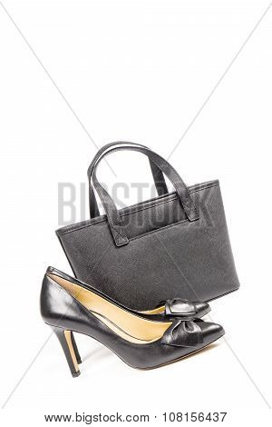 Black Leather Stilettos Shoes and Handbag Isolated on White
