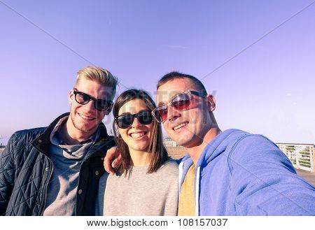 Three Youg Friends Taking Selfie On Sunny Autumn Day - Fashion  And Hipsterstyle Concept - Warm Ligh