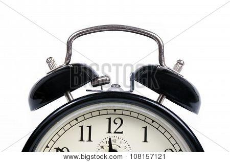 Classic old black alarm clock on white background