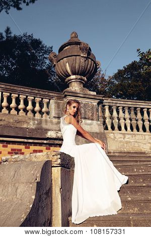 Beautiful Blond Woman Wears Wedding Dress,posing Beside Antic Villa