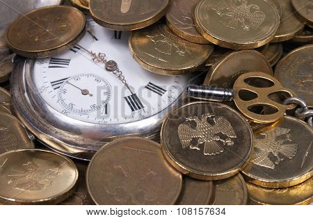 Coins and Antique pocket watch.